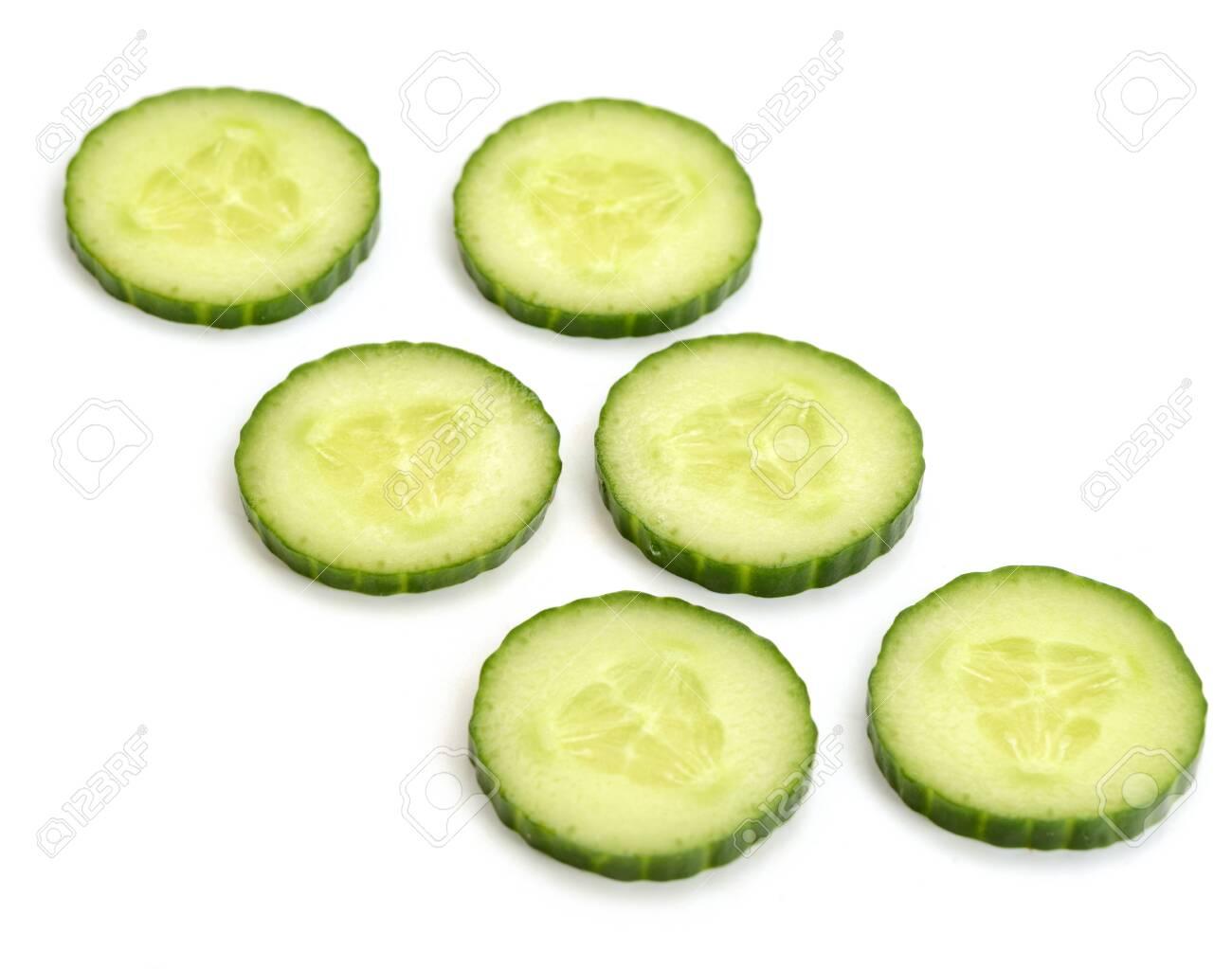 Fresh cucumber circle slices on white background - 142420214