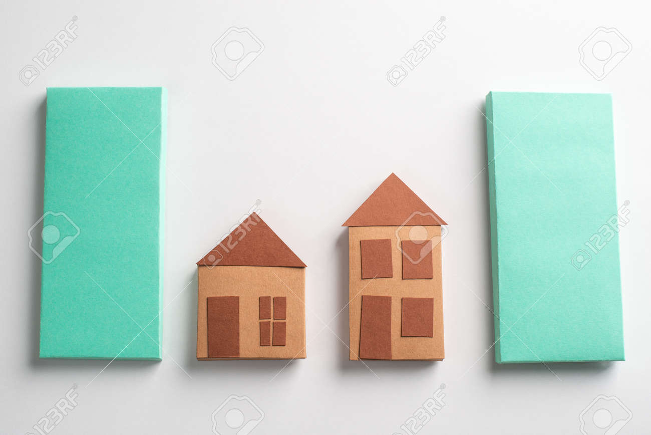 Paper houses made by a kid and green rectangles on white background - 173108131