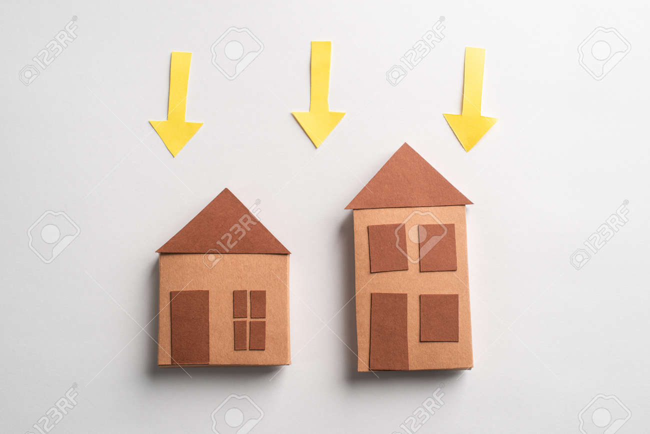 Cute brown 3d paper houses and yellow arrows pointing down - 173108140