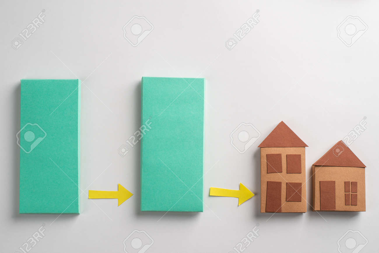 Green blocks, yellow arrows and paper houses on white background - 173108179