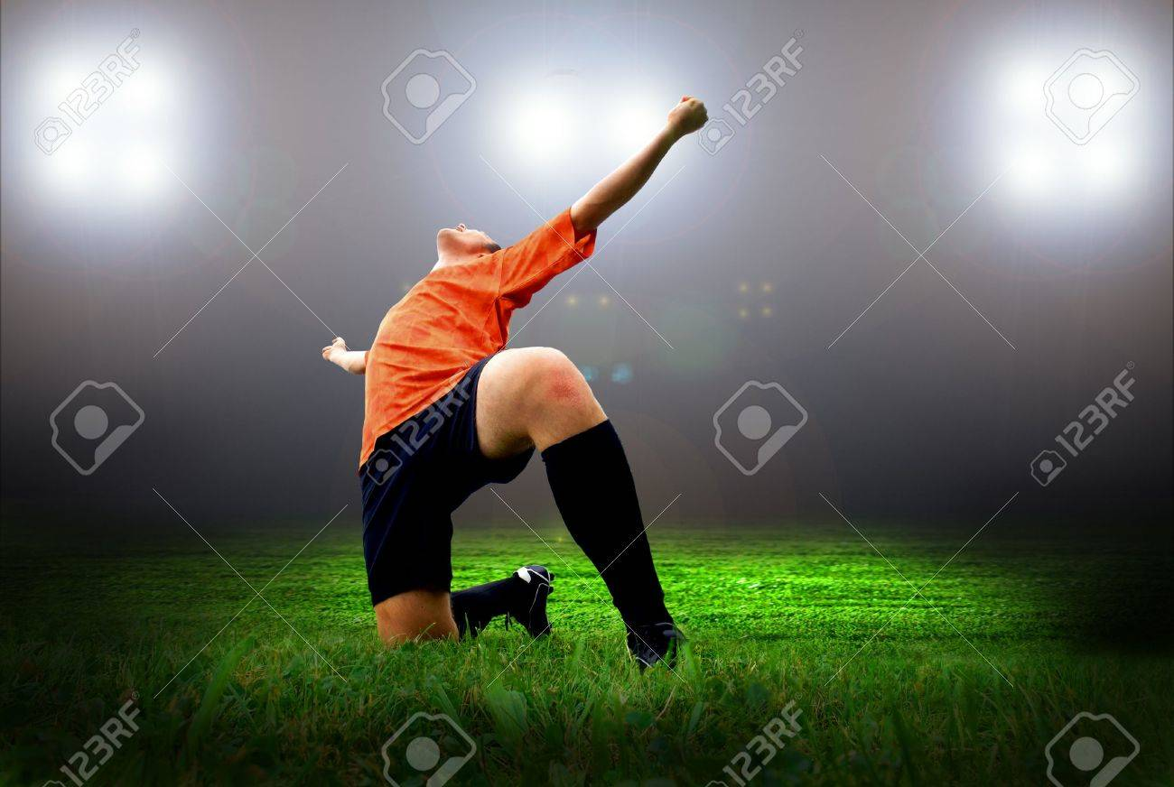 Happiness football player after goal on the field of stadium with light Stock Photo - 7772048