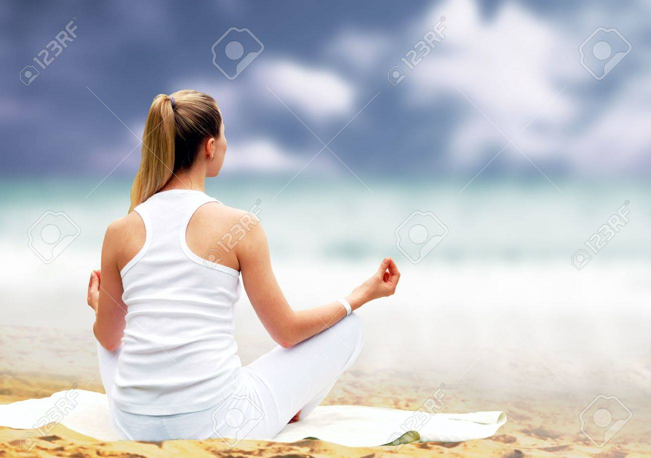 Young beautiful women in white, relaxation on the sunny tropical beach Stock Photo - 7851381