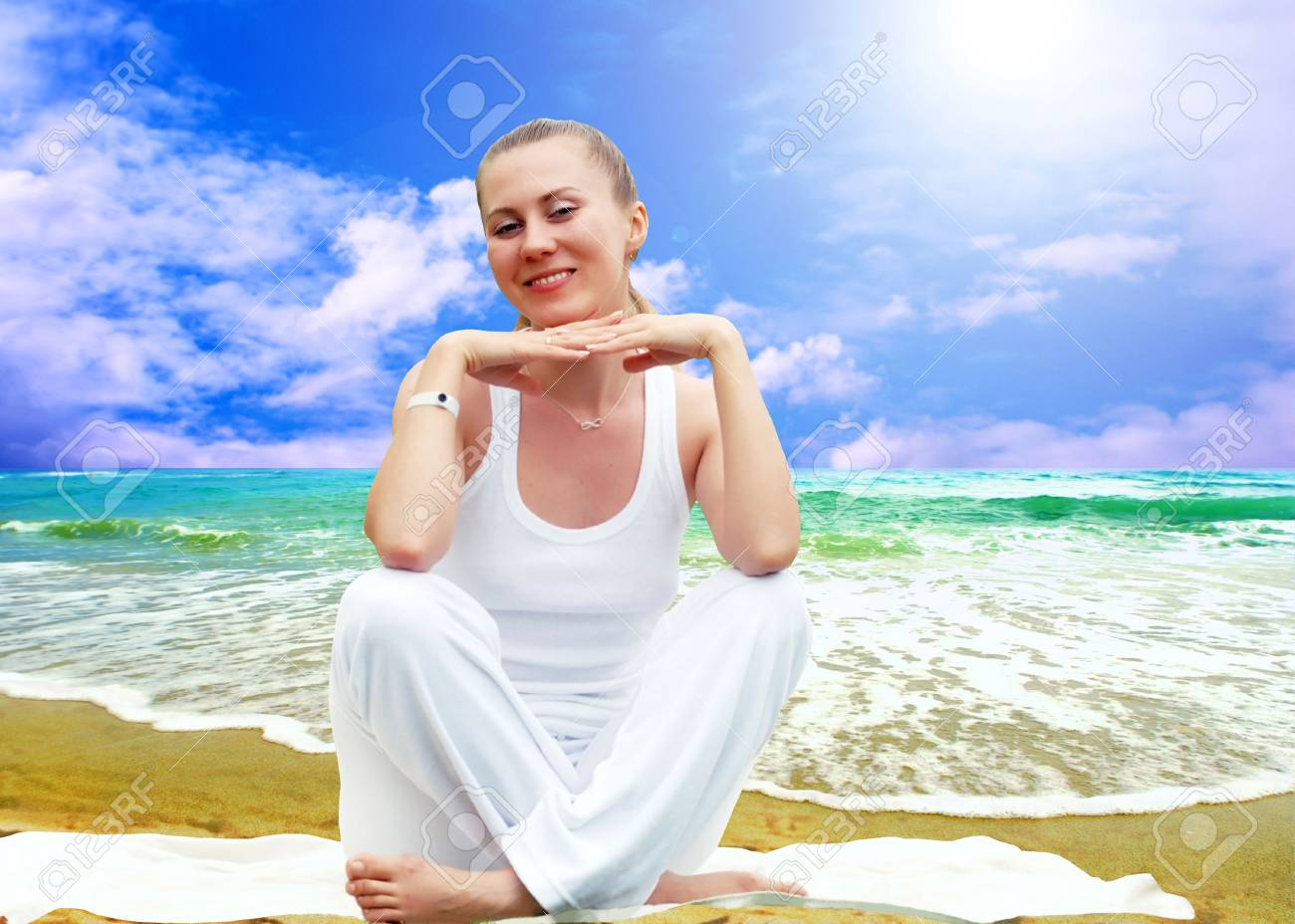 Young beautiful women in white, relaxation on the sunny tropical beach Stock Photo - 7927999