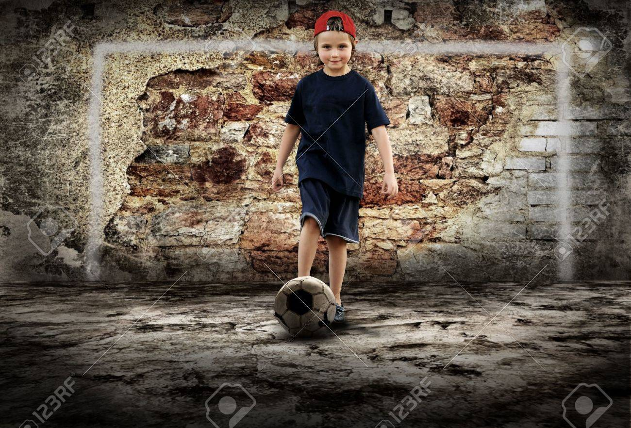 Football player and Grunge ball on the retro grunge background Stock Photo - 8114759