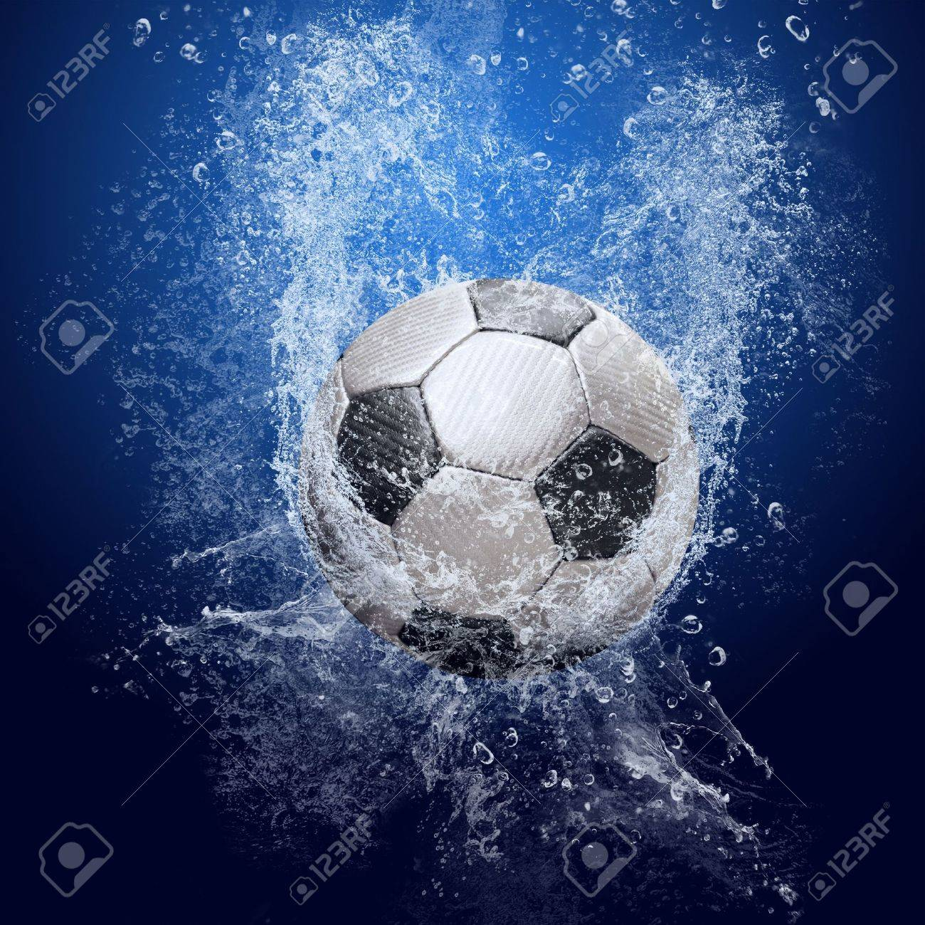 Water drops around soccer ball on blue background Stock Photo - 8174618