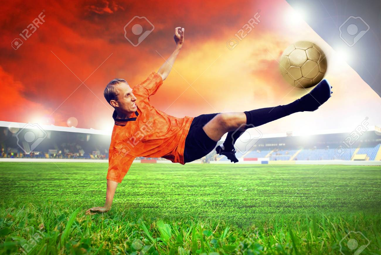 Happiness football player after goal on the field of stadium with blue sky Stock Photo - 8254900