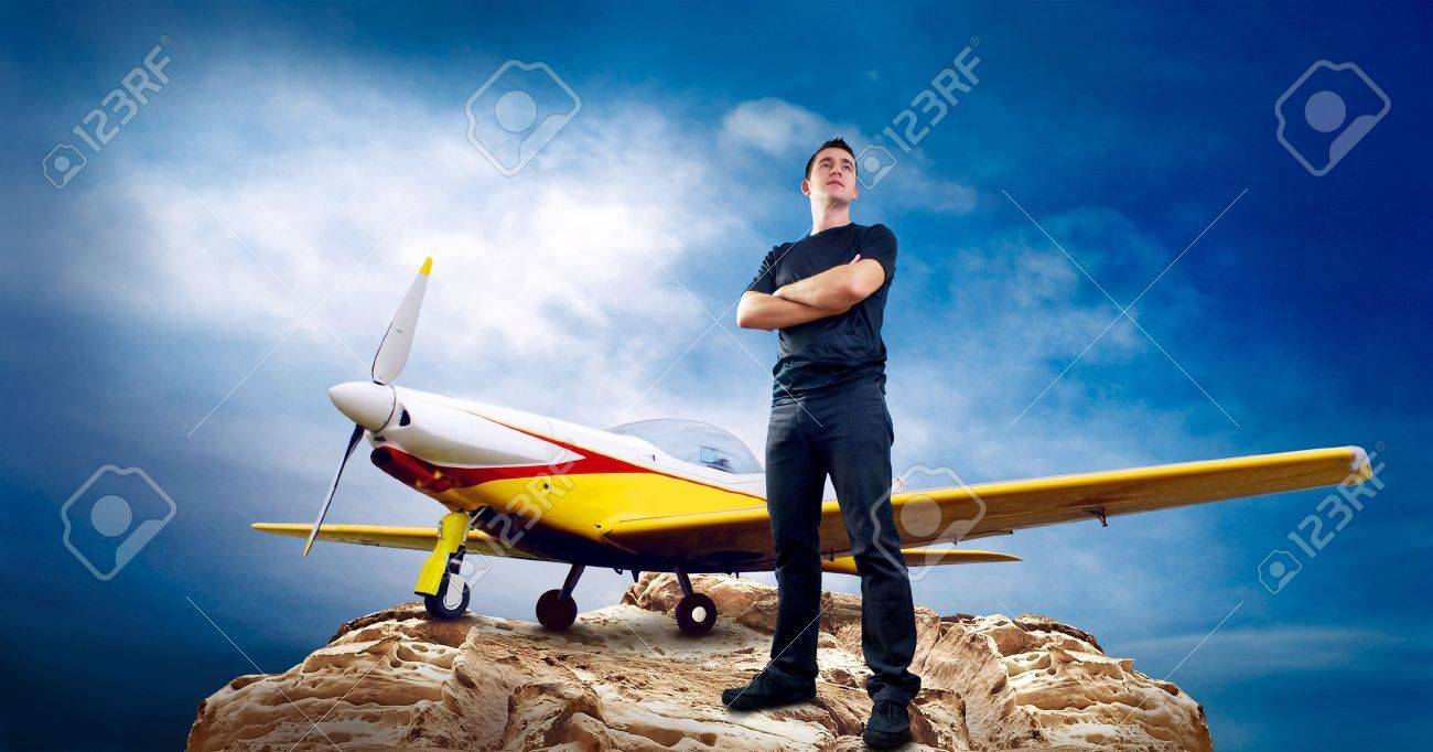 Man on the top of mountain and airplane Stock Photo - 8255108