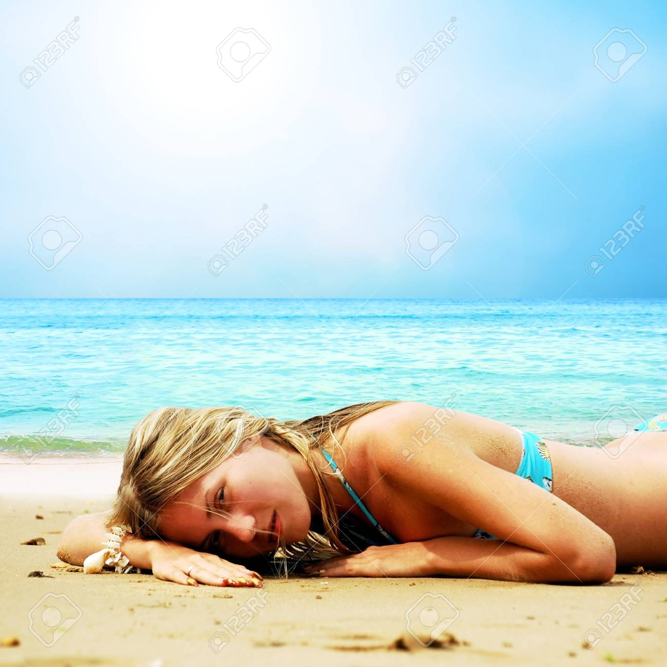 Young beautiful women on the sunny tropical beach in bikini Stock Photo - 8590657