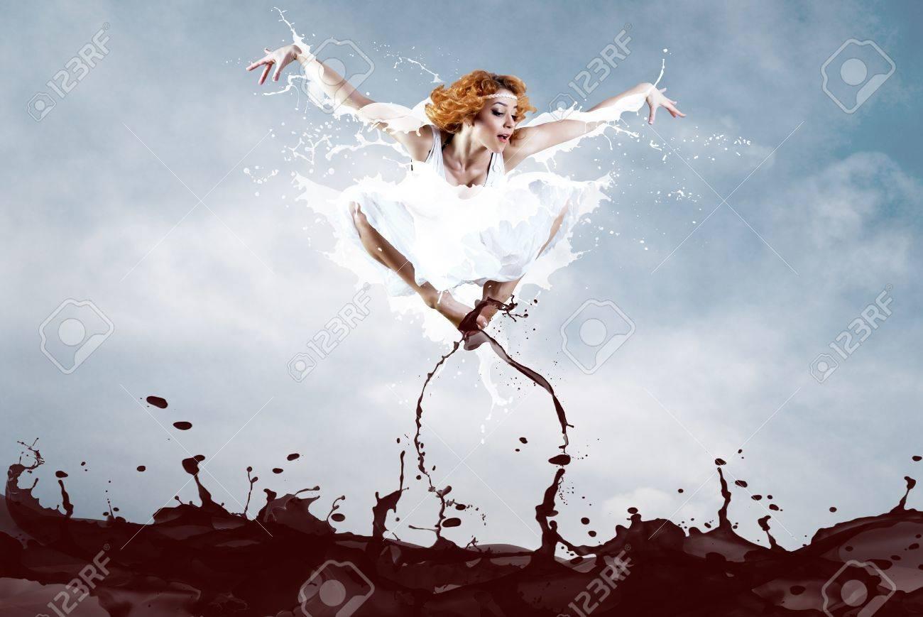 Jump of ballerina with dress of milk Stock Photo - 8996262