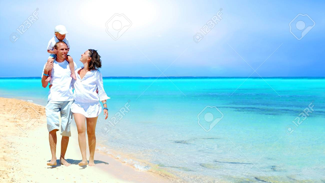 View of happy young family having fun on the beach Stock Photo - 9788757