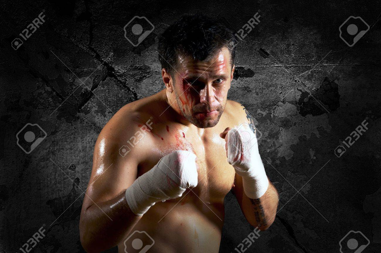 Aggressive boxer with blood on the face Stock Photo - 9788957