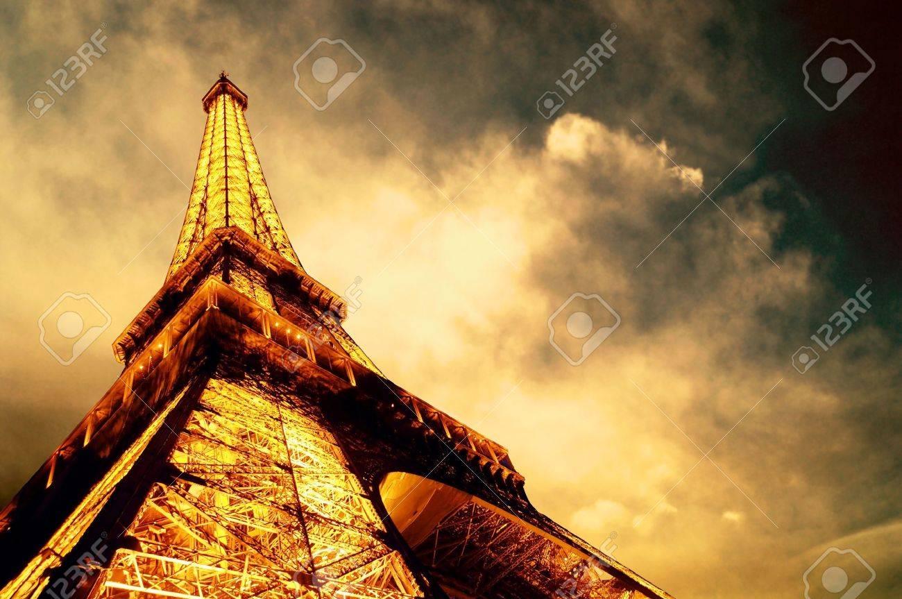 PARIS - JUNE 22 : Illuminated Eiffel tower at night sky June 22, 2010 in Paris. The Eiffel tower is one of the most recognizable landmarks in the world. Stock Photo - 9891006