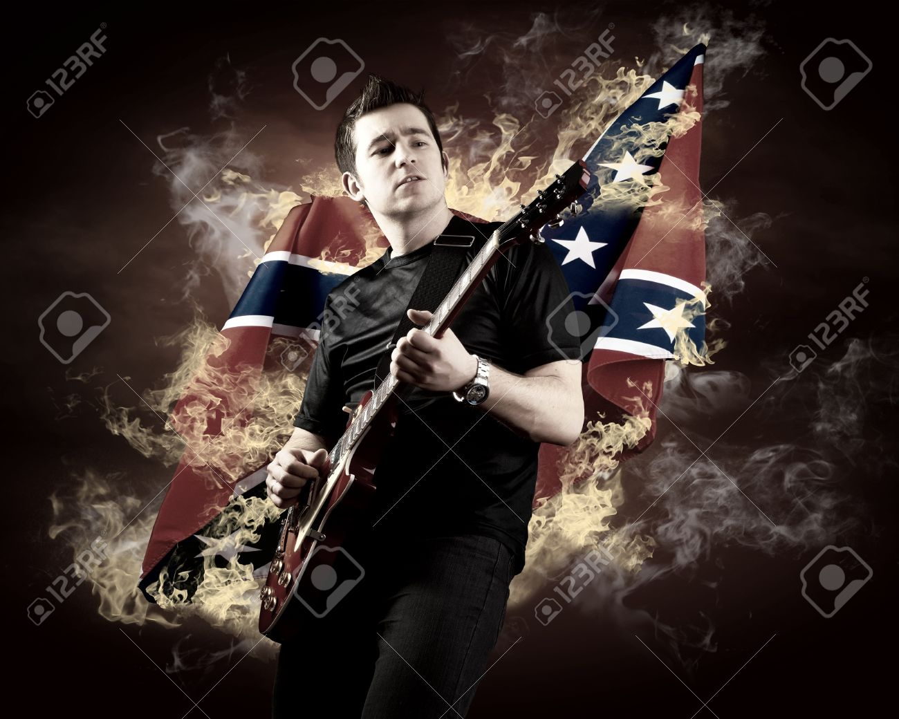 Rock guitarist play on the electric guitar around fire flames Stock Photo - 10560619