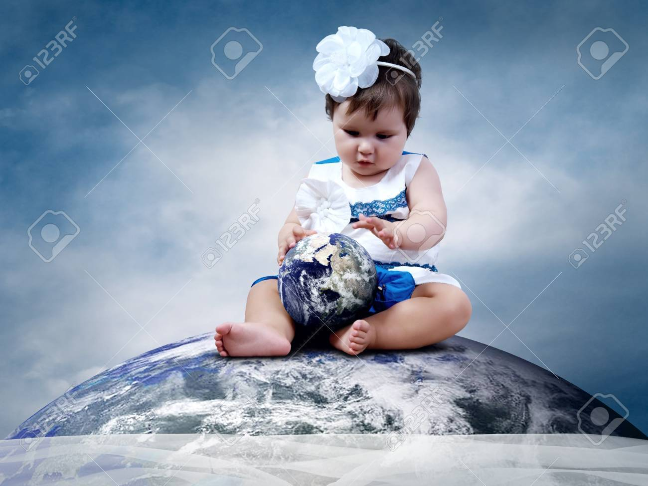Child sitting on the Planet Earth with globes in hands Stock Photo - 11544720