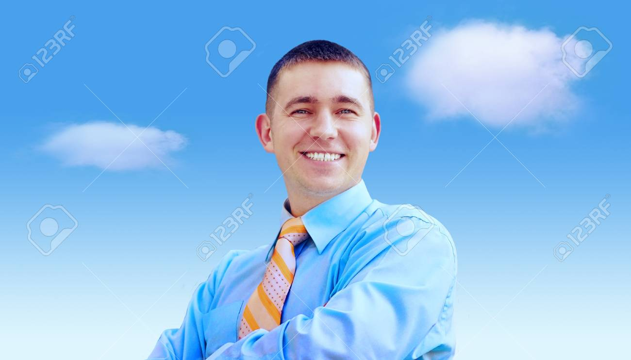 Hasppiness businessman under blue sky with clouds Stock Photo - 11544729
