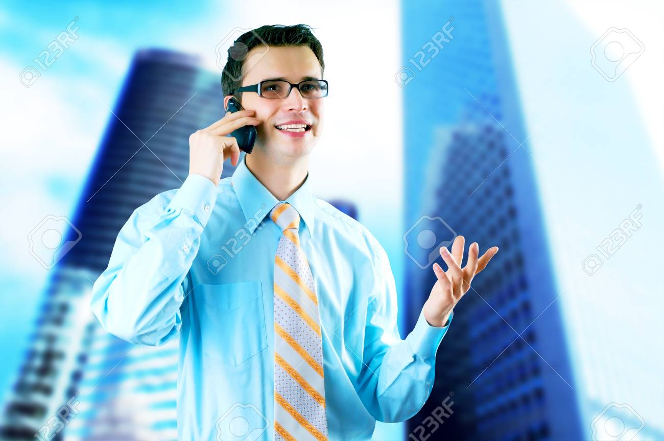 Hapiness Businessman standing on the business background Stock Photo - 12973060