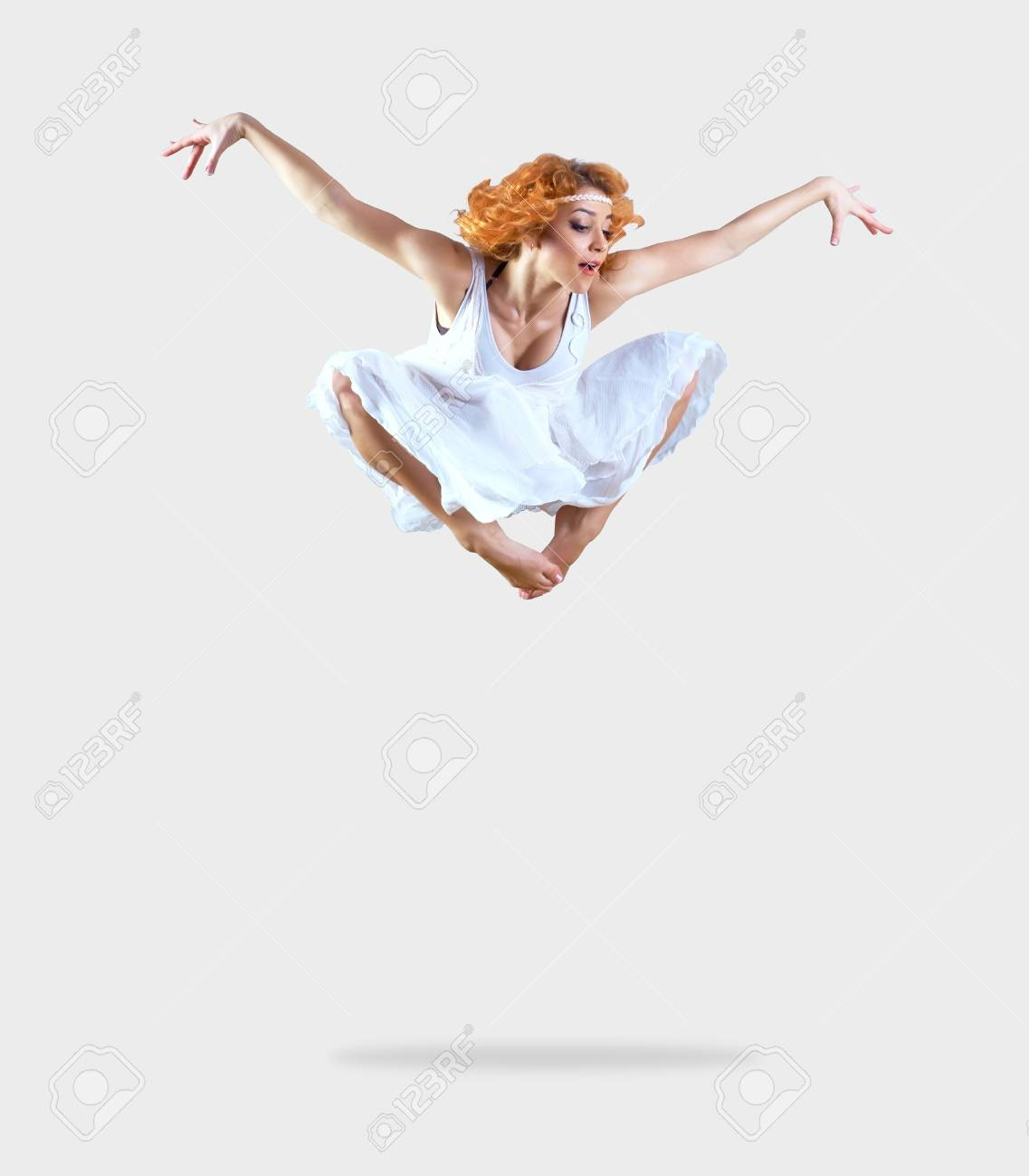 Woman dancer jump posing on background Stock Photo - 13484474