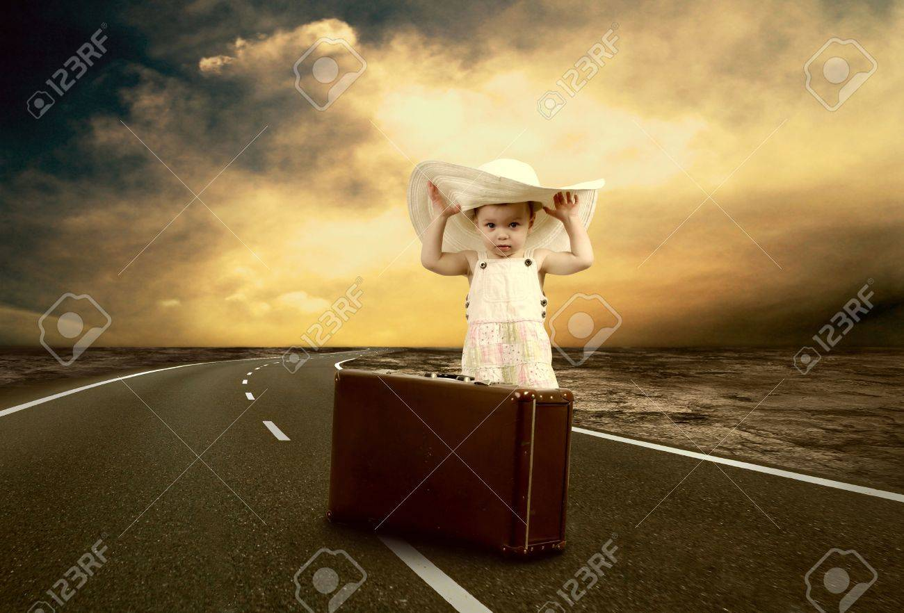 Little girl waiting on the road with her vintage baggage Stock Photo - 13568793