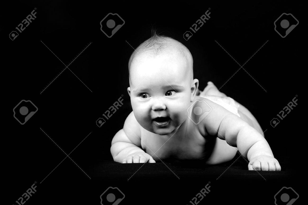 Four months baby on the dark background Stock Photo - 16581990