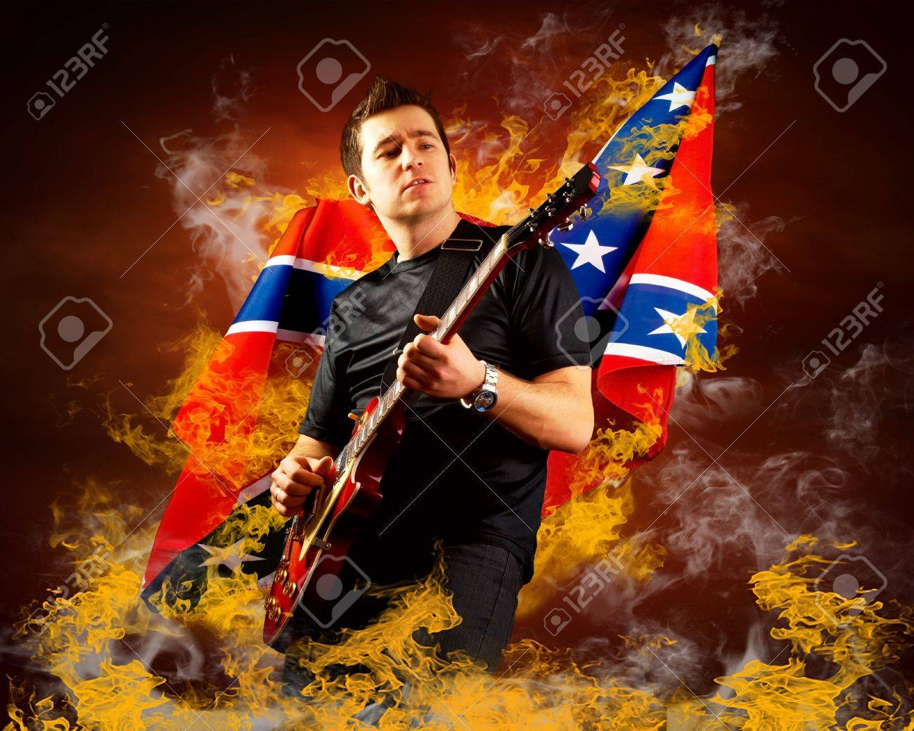Rock guitarist play on the electric guitar around fire flames Stock Photo - 17255345