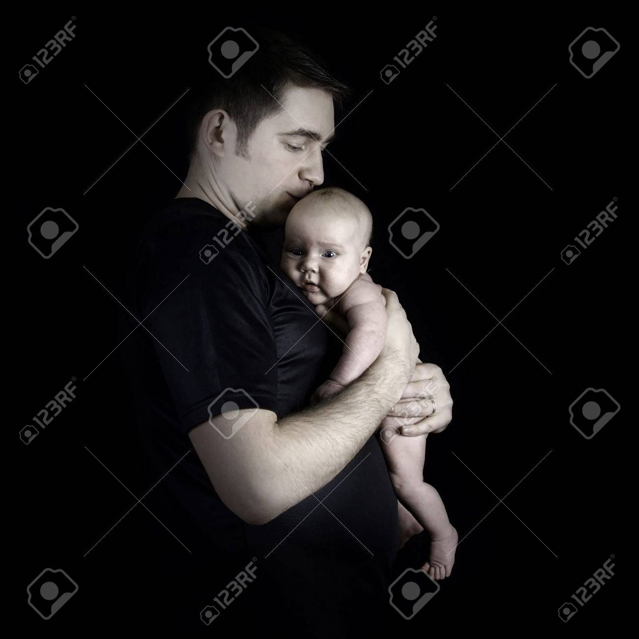 Newborn baby on the fathers hands Stock Photo - 18476489