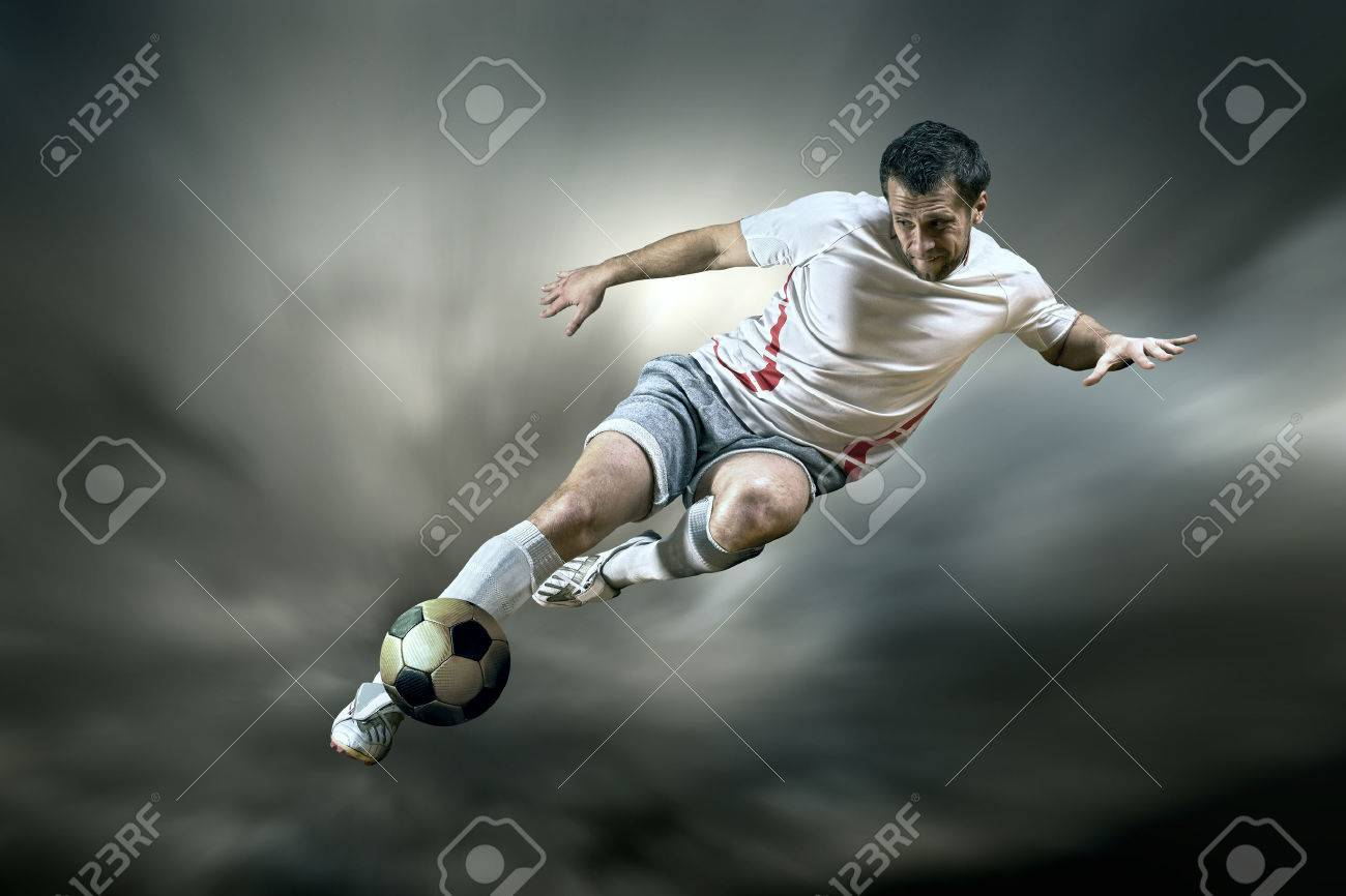 Football player with ball on field of stadium Stock Photo - 24259905