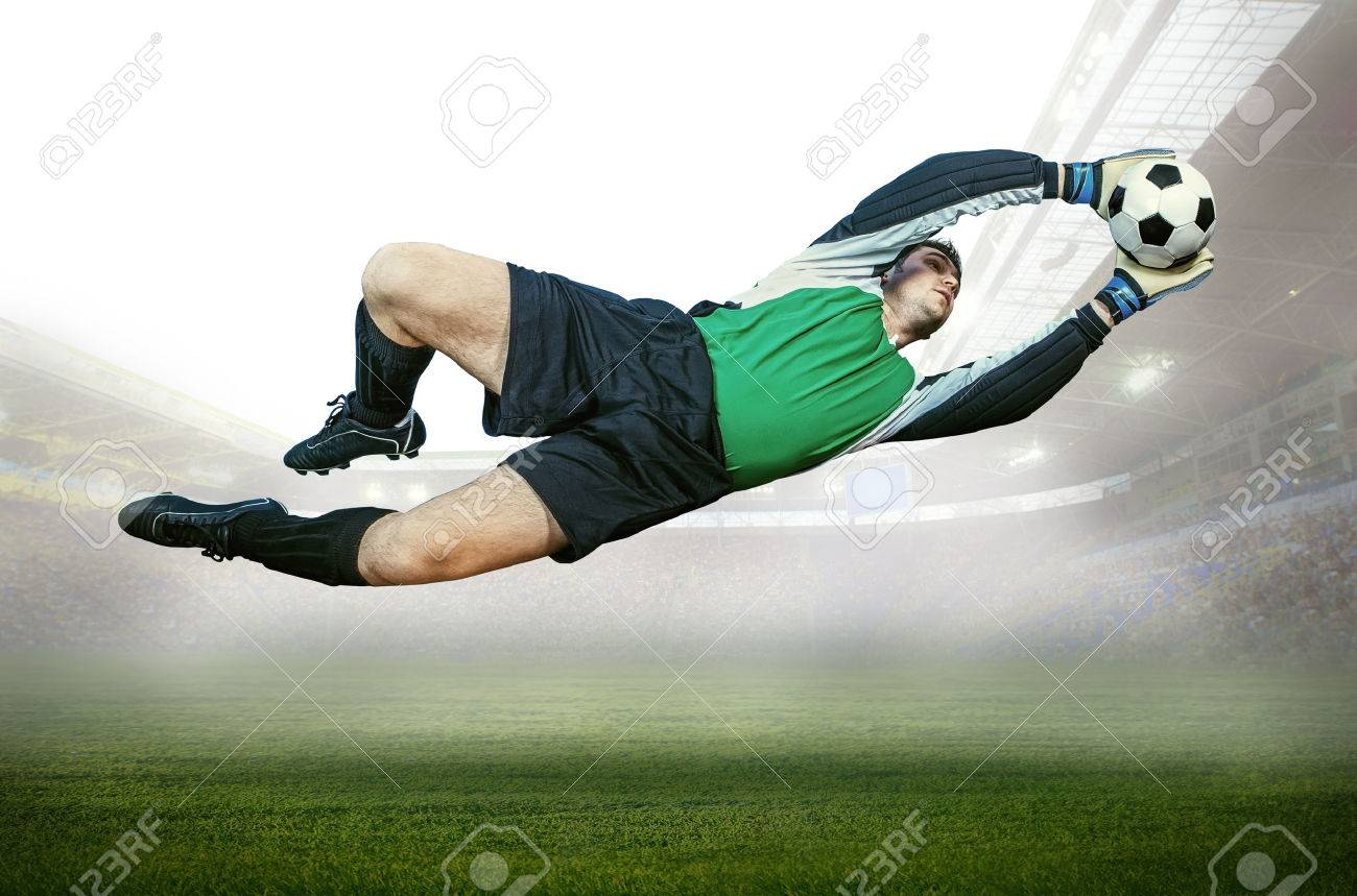 Football goalkeeper in action on field of stadium Stock Photo - 24259939
