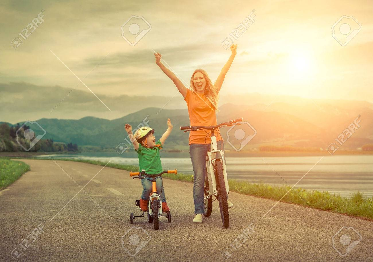 Happiness Mother and son on the bicycles funning outdoor Stock Photo - 45868719