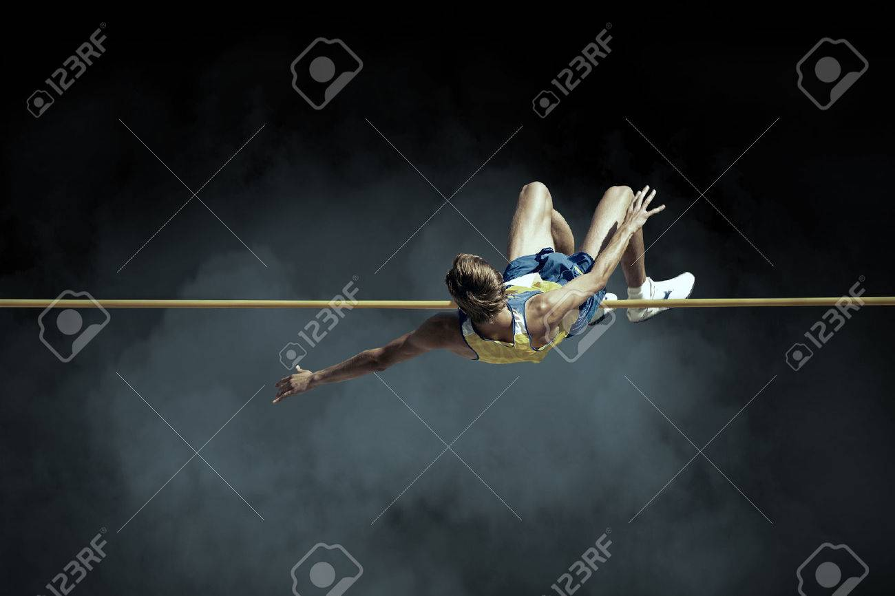Athlete in action of high jump. - 58555642