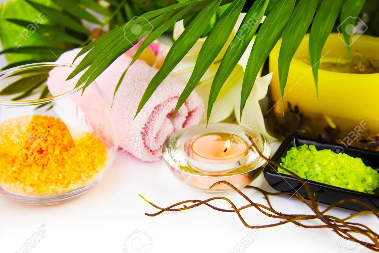 Spa setting with candle, salt and palm branch.  (With sample text) Stock Photo - 12206894