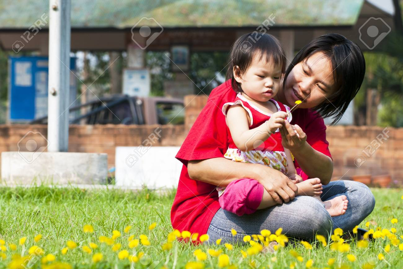 Asian Family in green Lawn Stock Photo - 12951601