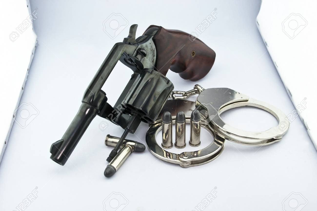 handgun revolver and police handcuff with bullets on white background Stock Photo - 15408742