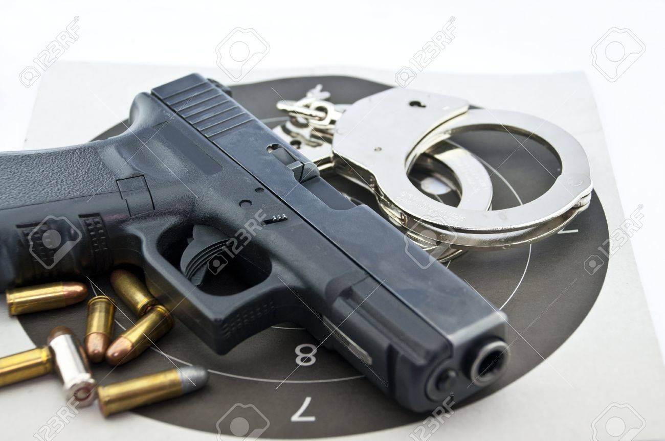 9-mm handgun automatic and police handcuff with bullets  on white background Stock Photo - 15423833