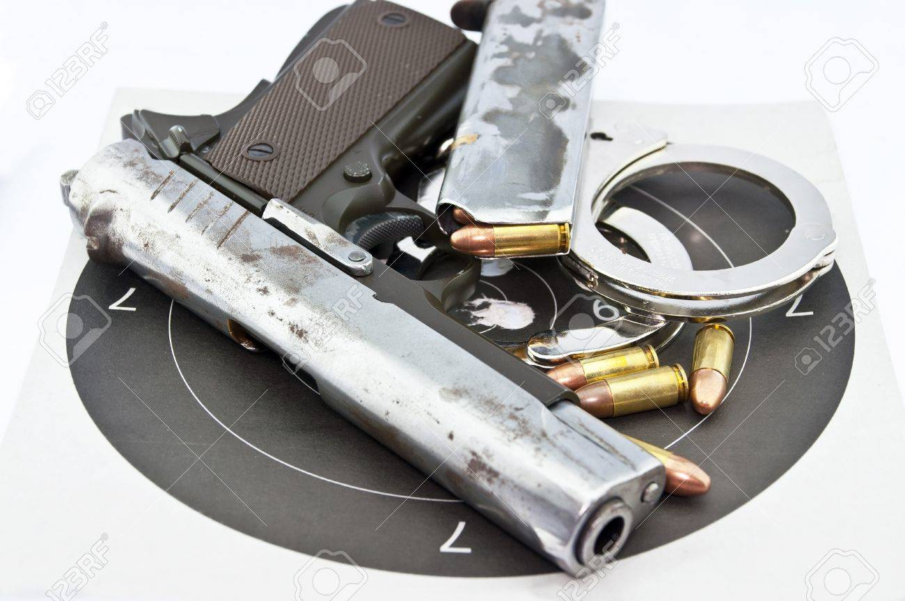 9-mm handgun automatic and police handcuff with bullets  on white background Stock Photo - 15423836