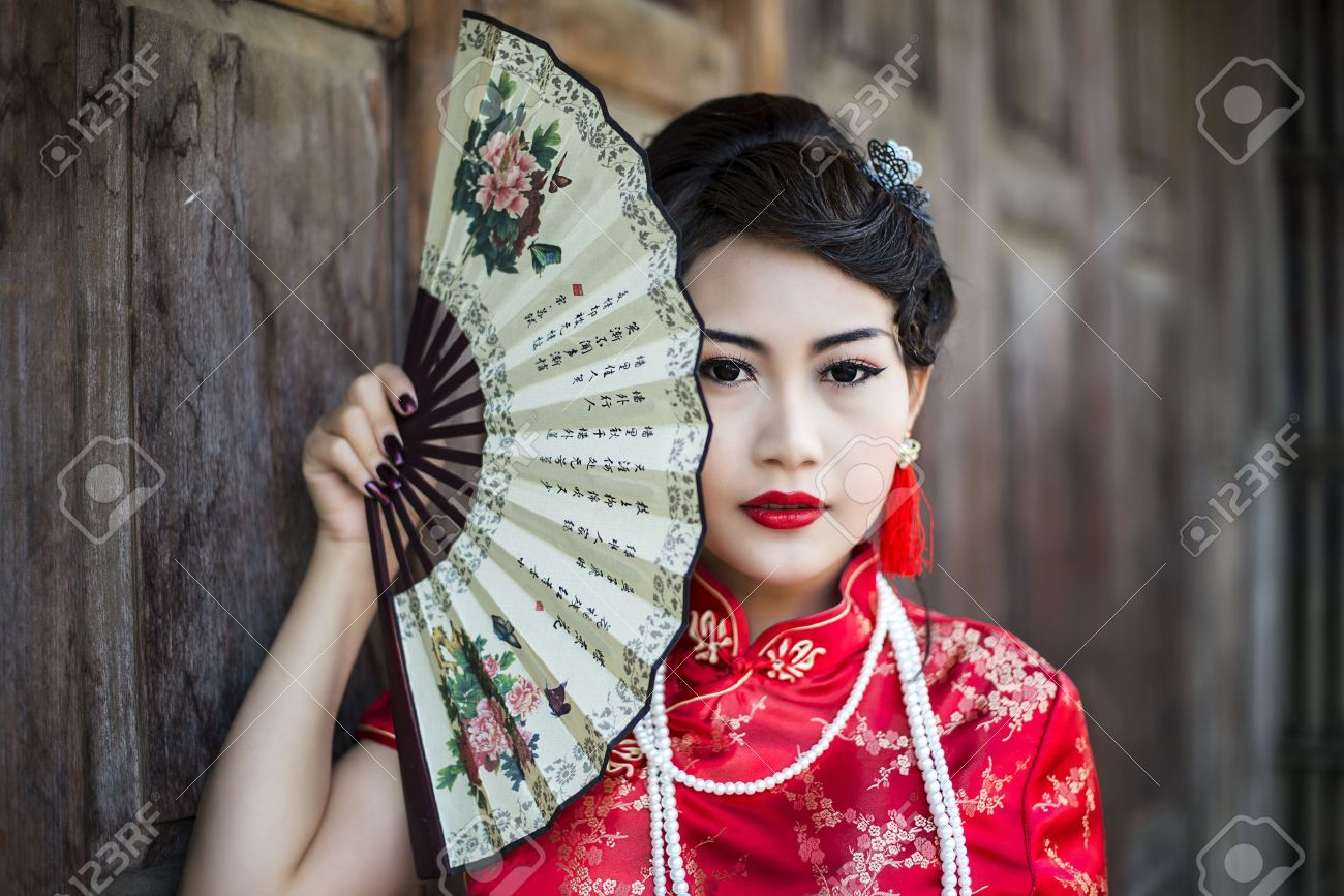 Chinese girl in traditional Chinese cheongsam blessing Stock Photo - 17846771