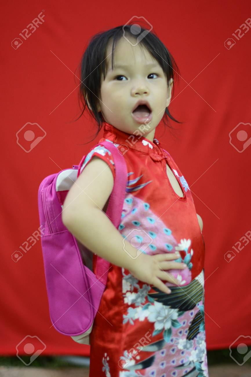 China girl in traditional chinese red tang suit greeting and stock china girl in traditional chinese red tang suit greeting and play smartphone stock photo 17846837 m4hsunfo