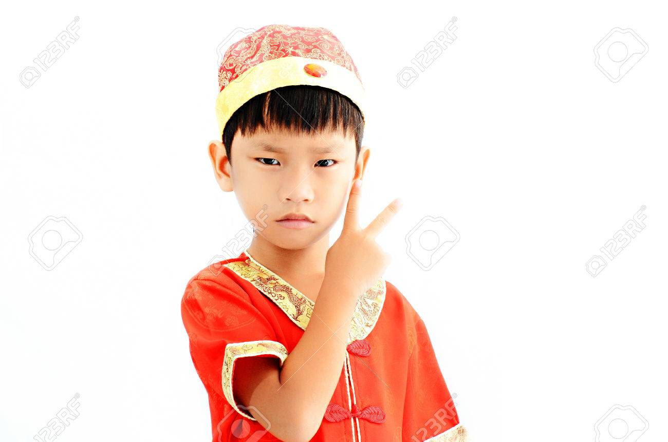 China boy in traditional chinese red tang suit greeting stock photo china boy in traditional chinese red tang suit greeting stock photo 29122449 m4hsunfo
