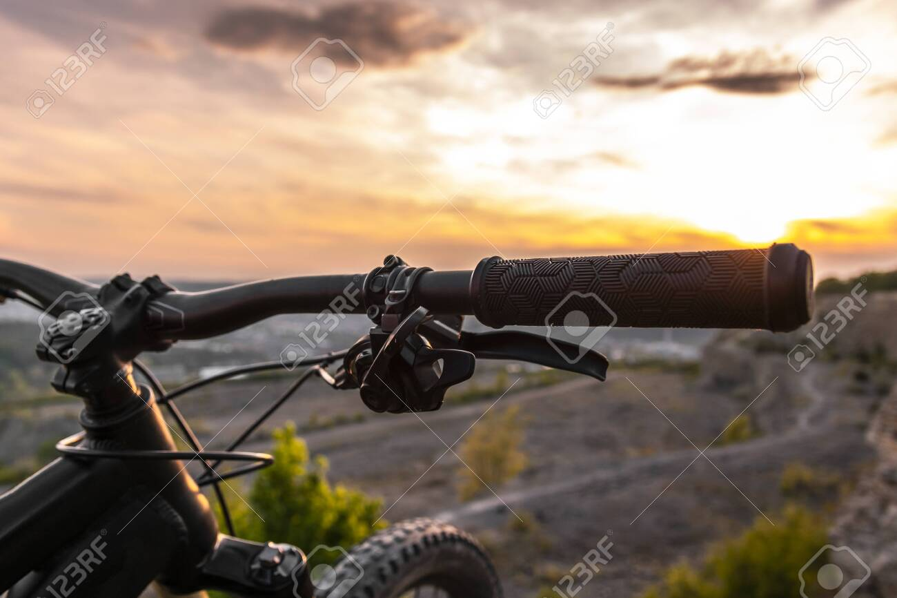 Detail Of Bicycle Handlebar Grip Mountain Bikes At Sunset Stock Photo Picture And Royalty Free Image Image 145945743