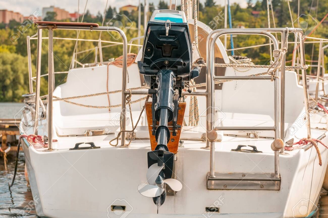 Ship propeller. Back shot of boat with outboard engine. - 148718816