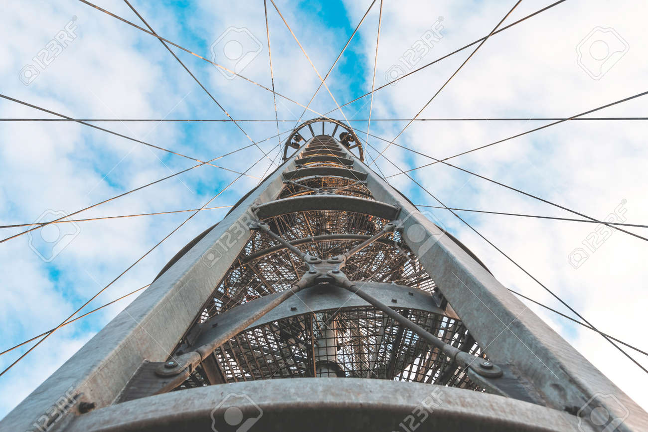 View from below on the metal structure of the lookout tower. Modern urban architecture. - 162631413