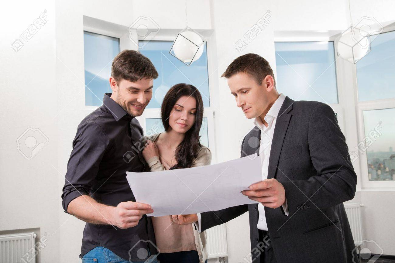 couple is considering the future design of the apartment with a designer Stock Photo - 19750479
