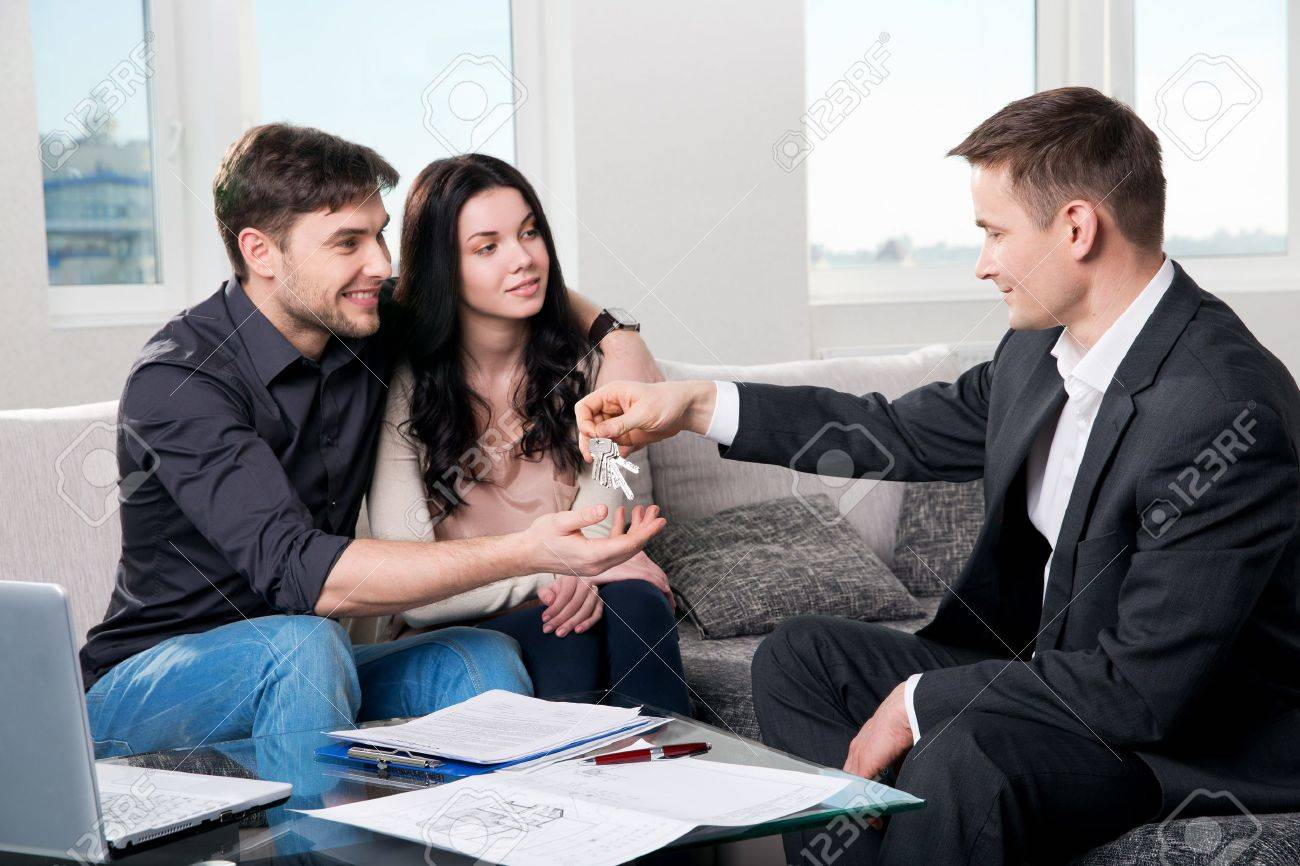 Happy couple with real estate agent Stock Photo - 19915814