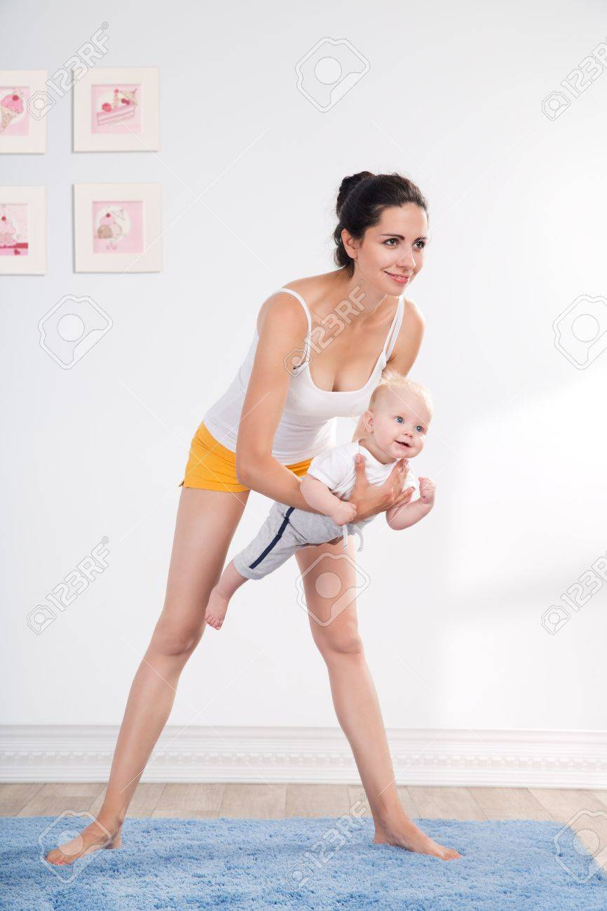 young mother does physical fitness exercises together with her baby Stock Photo - 20054411