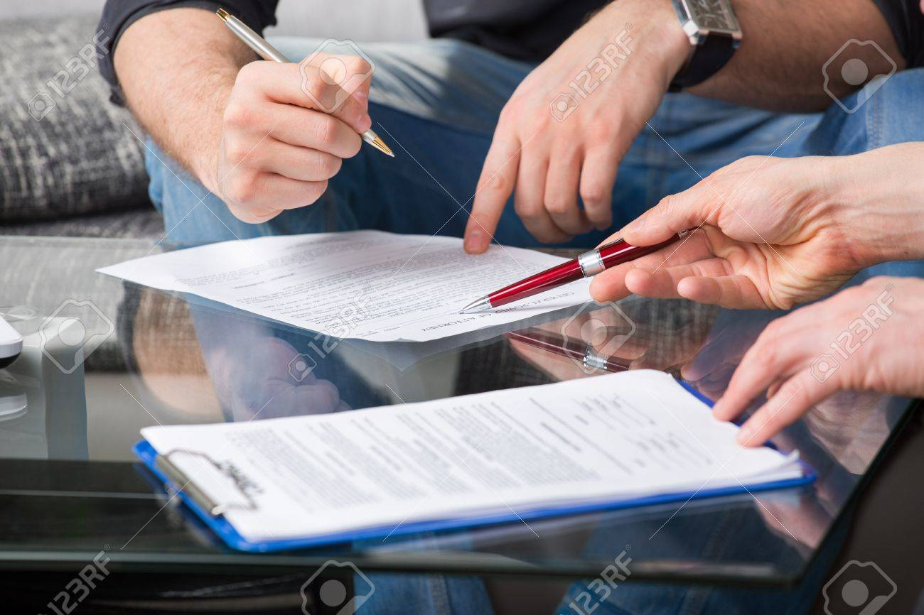 Hands of people signed the document, sitting at the desk Stock Photo - 20753314