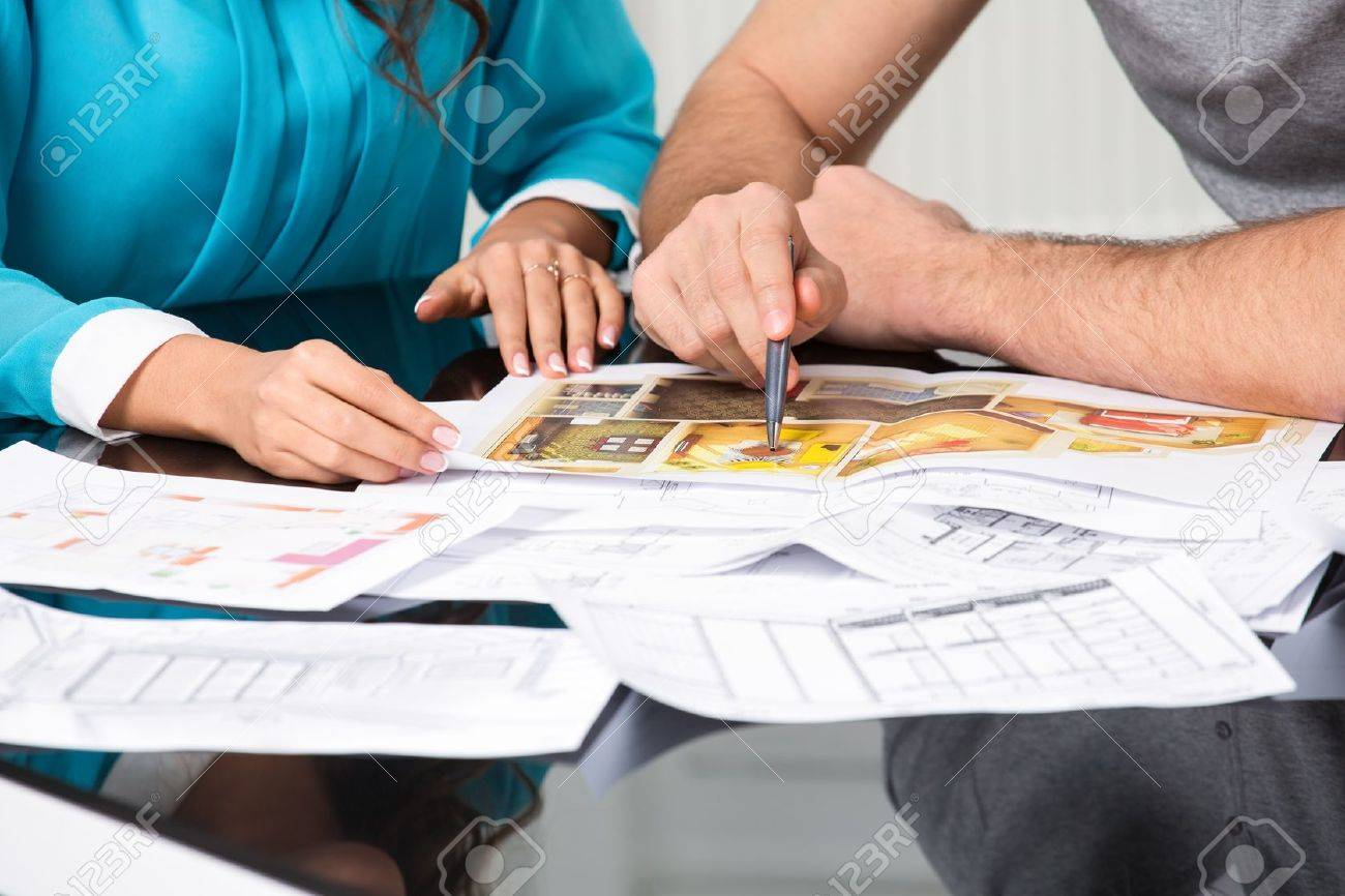 couple is considering the future design of the apartment, hands close-up Stock Photo - 20753317
