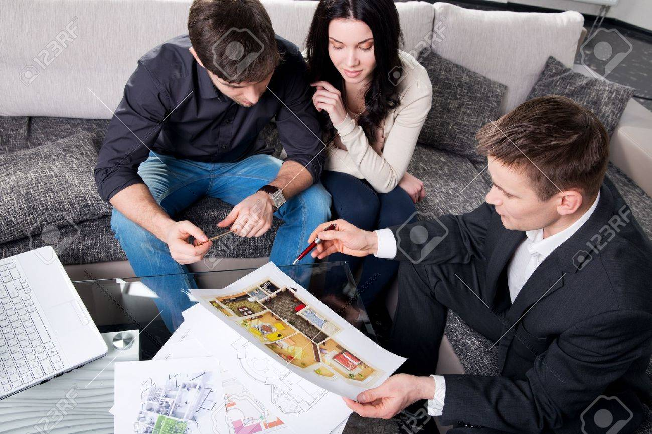 couple is considering the future design of the apartment with a designer, top view Stock Photo - 20865512
