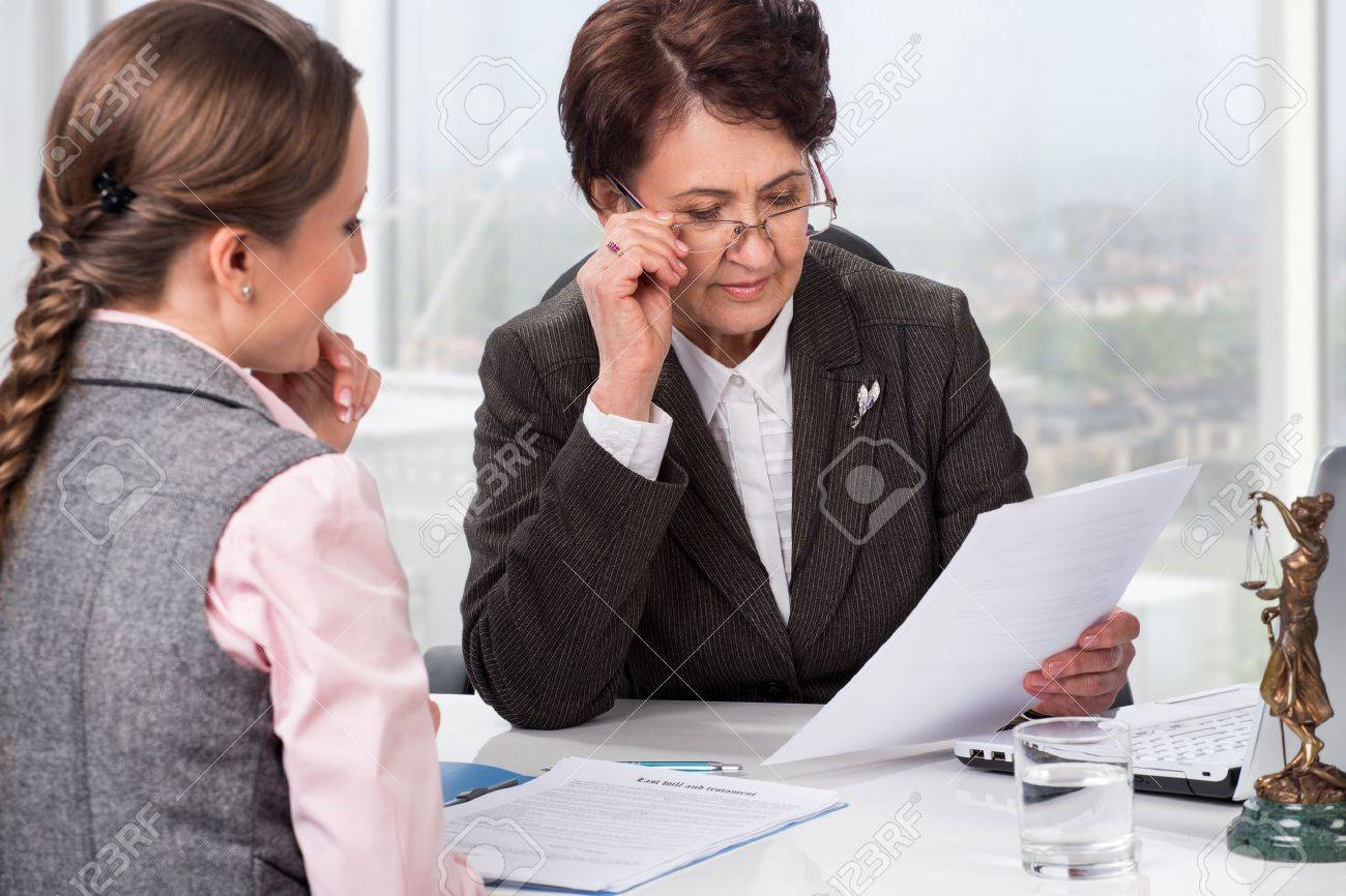 Lawyer or notary in the workplace advising a woman Stock Photo - 21199079