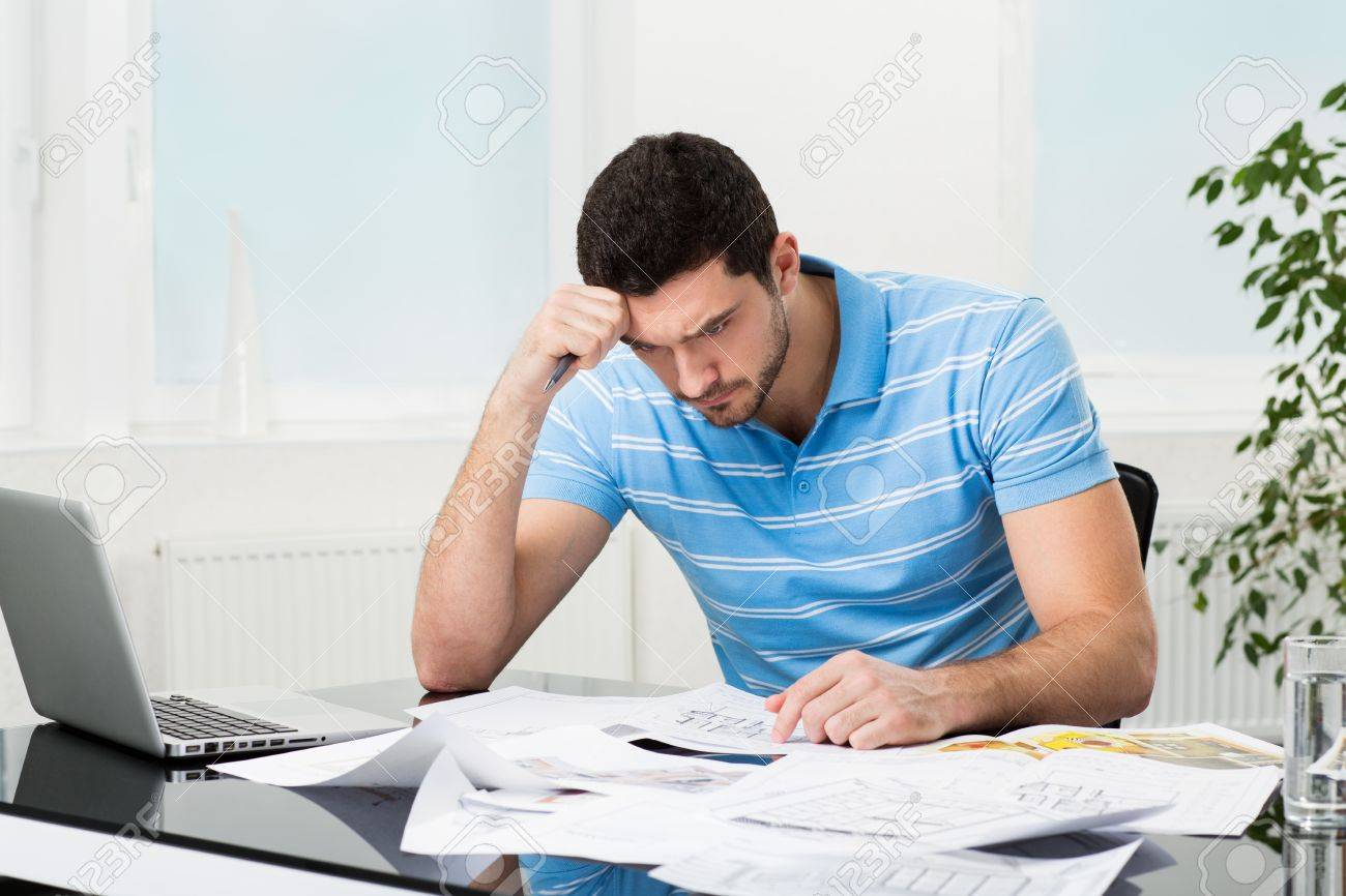 Puzzled Handsome Interior Designer Or Architect At Workplace Stock Photo    21199080
