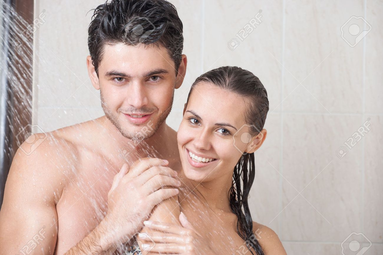 Young couple washing their heads in the shower Stock Photo - 21199085