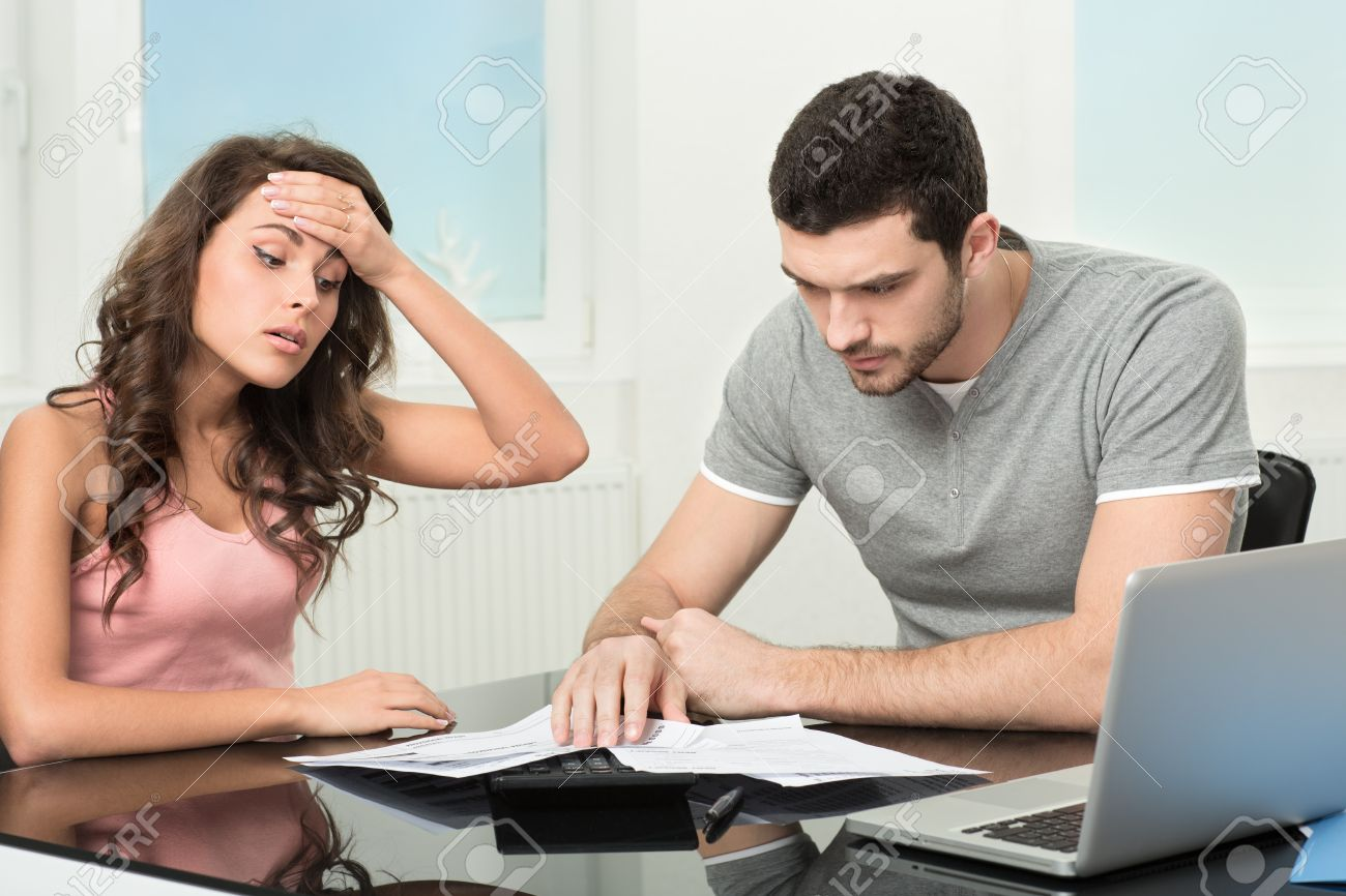 Couple, Man angry and upset after looking at credit card statement Stock Photo - 21199086